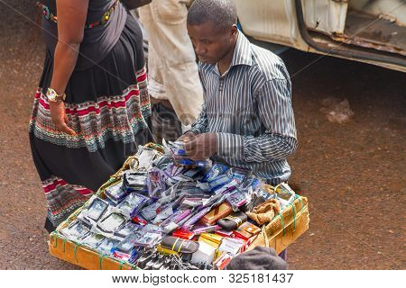 Kampala, Uganda - October 03, 2012.  A Man Sells Cell Phone Cases At The Taxi Park In Kampala, Ugand