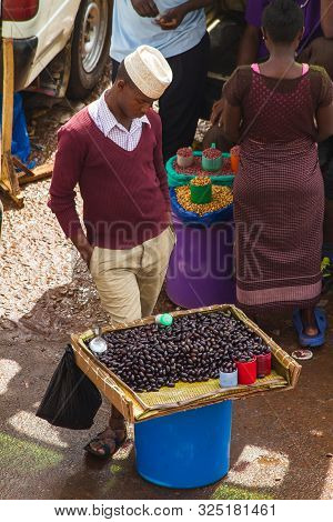Kampala, Uganda - October 03, 2012.  A Young Man Stands By His Tray Of Beans For Sale At The Taxi Pa