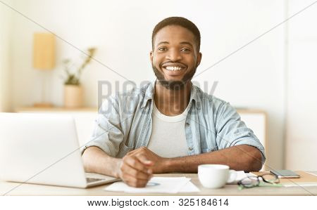 Working At Home. Portrait Of Happy African American Freelancer Sitting At Workplace In Home Office,