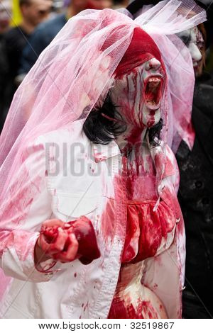 MOSCOW - MAY 14: Shouting out live dead bride participant with a viscera in the hand and with a bloody bandage on the eyes at Zombie Parade on Old Arbat, May 14, 2011, Moscow, Russia.