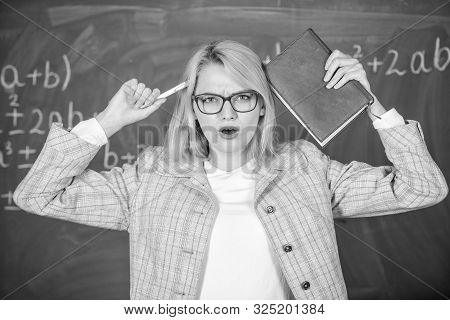 Inspiring Educator Spark Motivation. Educator Woman Hold Book And Pen Chalkboard Background. Looking