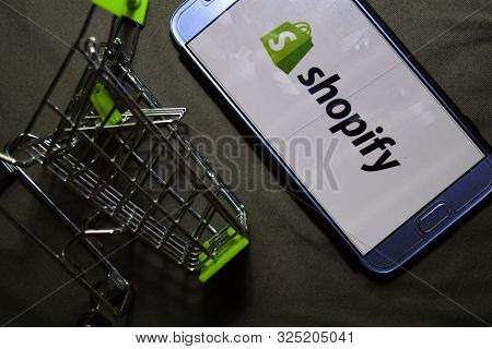 Bekasi, West Java, Indonesia. October 2, 2019 : Shopify Dev App On Smartphone Screen. Shopify Is A F