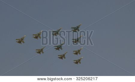 Fighters Su-35 And Mig-29 Lined Diamond Fly With Fireworks Fly In Sky On Training Parade In Honor Of