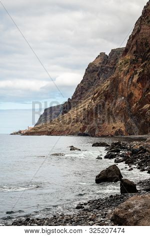 Pebble Beach At The Foot Of A Cliff In Madeira