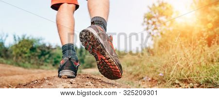 Trekking Boot Sole Close Up Image Traveler Feet In Trekking Boots On Mountain Dirty Path At Summerti