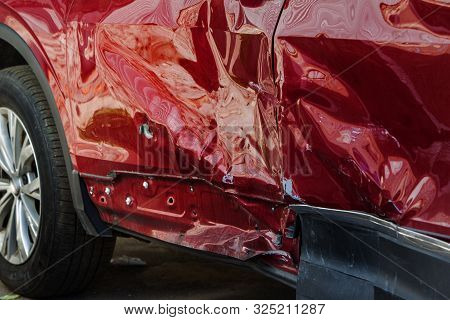 The Body Of The Car Is Damaged As A Result Of An Accident. High Speed Head On A Car  Traffic Acciden