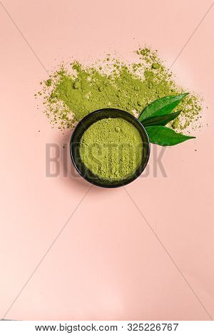 Matcha Green Tea Powder Close Up On Colored Background