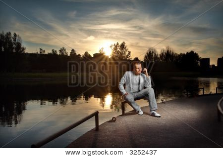 Businessman In White On The Sunset
