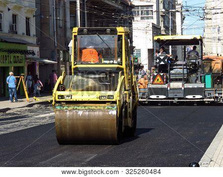 Belgrade, Serbia, October 1, 2019. Steamroller And Paver Finishing Asphalt Street In Downtown.