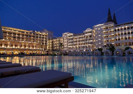 Antalya, Turkey - September 12, 2019: Exterior And Swim Pool At Night Of Titanic Mardan Palace Luxur