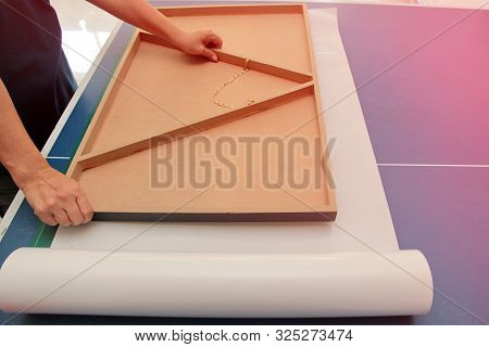 Photo Frame Technician Is Placing The Floating Frame Over The Double Sided Adhesive. To Stick Togeth