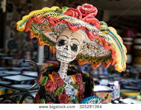 La Calavera Catrina -mexican Colorful Traditional Souvenirs. The Symbol Of The Holiday Of The Day Of
