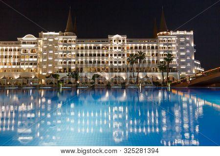 Antalya, Turkey - September 12, 2019: Exterior And Swim Pool At Night Of Titanic Mardan Palace Elite