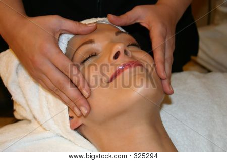 Woman Smiles While Getting Facial