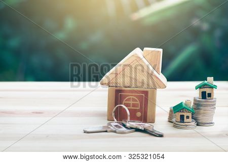 House Is Placed On A Coin. Houses, Keys Placed On A Wooden Table.  Planning Savings Money Of Coins T