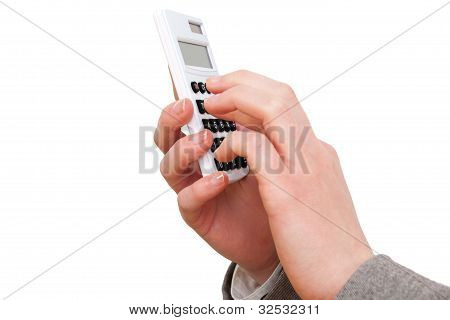 Female hand with a calculator