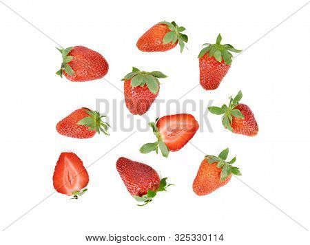Bird Eyes View Whole And Half Cut Fresh Ripe Strawberry With Leaf On White Background