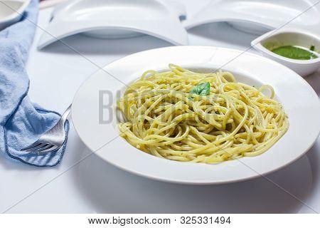 Homemade Italian Spaghetti With Pesto Sauce And Basil