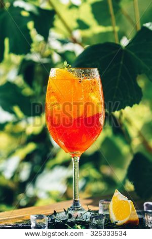 Aperol Spritz Cocktail In Big Wine Glass Close Up With Oranges, Summer Italian Fresh Alcohol Cold Dr