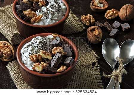 Two Cups With Yogurt With Chia Seeds, Walnuts And Dark Chocolate. Breakfast Or Dessert For Two. Heal