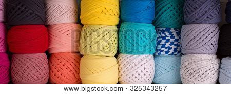 Skeins Of Colored Knit Yarn Closeup. Background From Various Skeins Of Yarn.