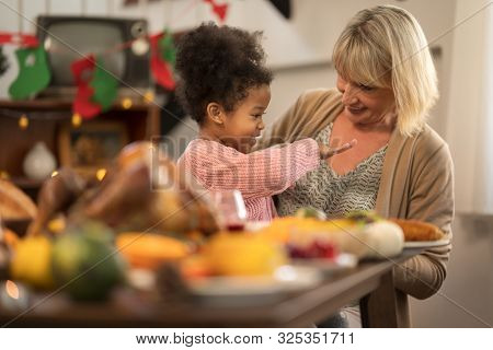Grandmother And Granddaughter Celebrating Thanksgiving Dinner At Home  .thanksgiving Celebration Tra