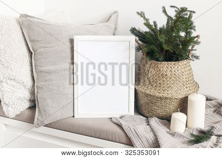 White Blank Wooden Frame Mockup With Christmas Tree, Candles, Linen Cushions And Plaid On The White