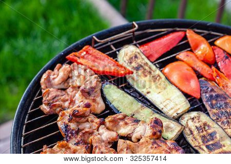 Assortment Of Fresh Healthy Colored Vegetables, Chicken Meat Grilled On Bbq Grilling Over A Hot Fire