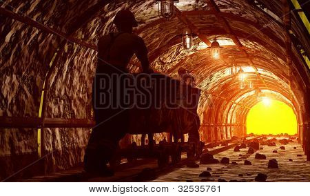 Workers pushing the cart in the mine.