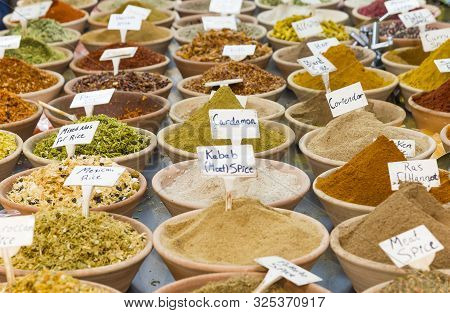 Piles Of Spices For Sale. Oriental Spices