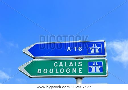 French Road Sign Pointing To Calais And Boulogne.