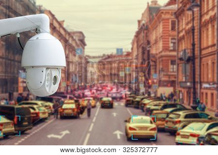 The concept of video surveillance and security technology. CCTV camera tracks violators of traffic rules during traffic congestion poster