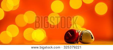 Christmas Decoration - Sittle Jingle Bells With Snow Falling On Red Background With Plenty Copy Spac