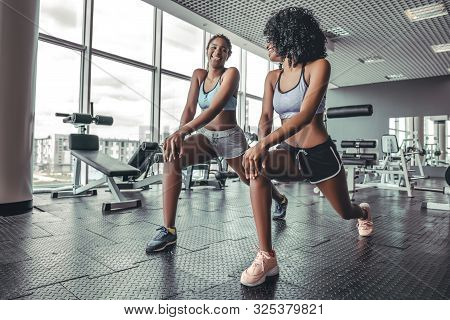 Fitness African Women Doing Lunges Exercises For Leg Muscle Workout Training In Gym. Active Black Gi