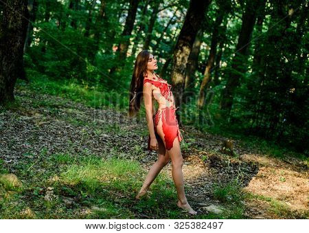 Forest Fairy. Living Wild Life Untouched Nature. Wild Woman In Forest. Sexy Girl Early Stage In The