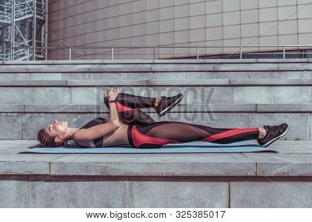 Girl Athlete Back Muscle Training And Leg Muscle Stretching, Abs Exercise, Sportswear, Top Leggings,
