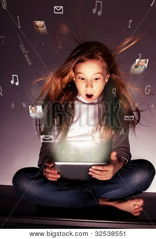 Surprised girl with tablets in hand. Flow of information, letters, photos departing from the tablet