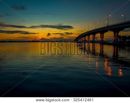 Background Of Pre-dawn Light Spreading Across The Sky Over The Indian River In Stuart, Florida As St