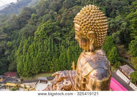 Puli, Taiwan - September 26th, 2019: big golden buddhist statue Puli Chengte Foshan at Puli township, Nantou, Taiwan