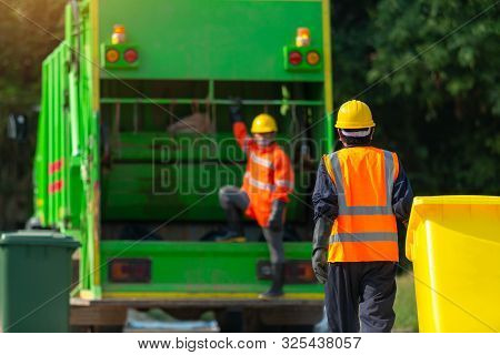 [garbage Collector] Asian Worker Of Urban Municipal Recycling Garbage Collector Truck Loading Waste