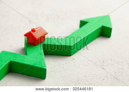 House And Red Up Arrow. Rising Real Estate Prices. Raising Insurance Or Tax Rates