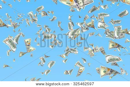Flying Dollars Banknotes Isolated On A Blue Background. Money Is Flying In The Air. 100 Us Banknotes