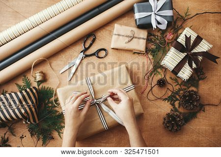 Merry Christmas, Flat Lay. Hands Wrapping Stylish Christmas Gift Box In Craft Paper And Scissors, Ru