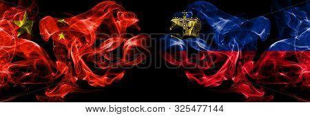 China Vs Liechtenstein, Liechtensteins Smoke Flags Placed Side By Side. Thick Colored Silky Smoke Fl