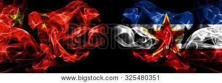 China Vs Yugoslavia Smoke Flags Placed Side By Side. Thick Colored Silky Smoke Flags Of Chinese And