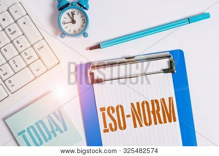 Writing note showing Iso Norm. Business photo showcasing An accepted standard or a way of doing things most showing agreed Flat lay above table with clock pc keyboard and copy space note paper. poster
