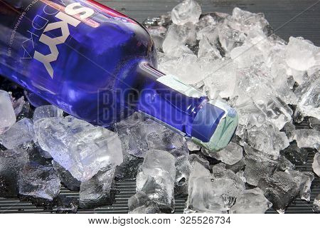 Cold Bottles Of Skyy Vodka On The Ice Cubes, Night Party