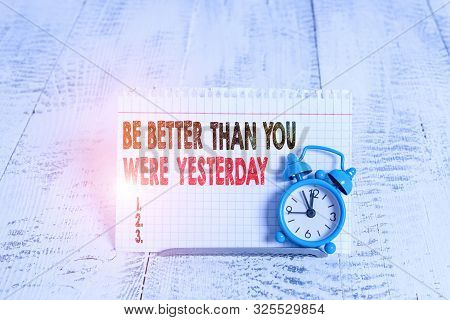 Conceptual hand writing showing Be Better Than You Were Yesterday. Business photo text try to improve yourself everyday. poster