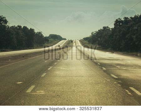 Caribbean Road Trip. A View South Along The Arterial Road North Of Cienfuegos In The North East Of C