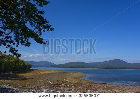 The Shoreline Of The Ashokan Reservoir In Upstate New York With The Catskill Mountains In The Backgr